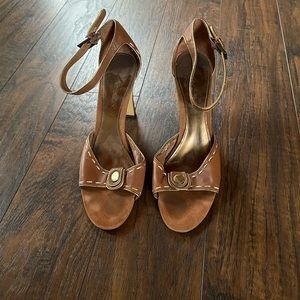 Tan block heels. Gold accents and stitching.